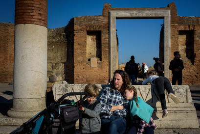 dad and kids in a piazza in Pompeii ruins