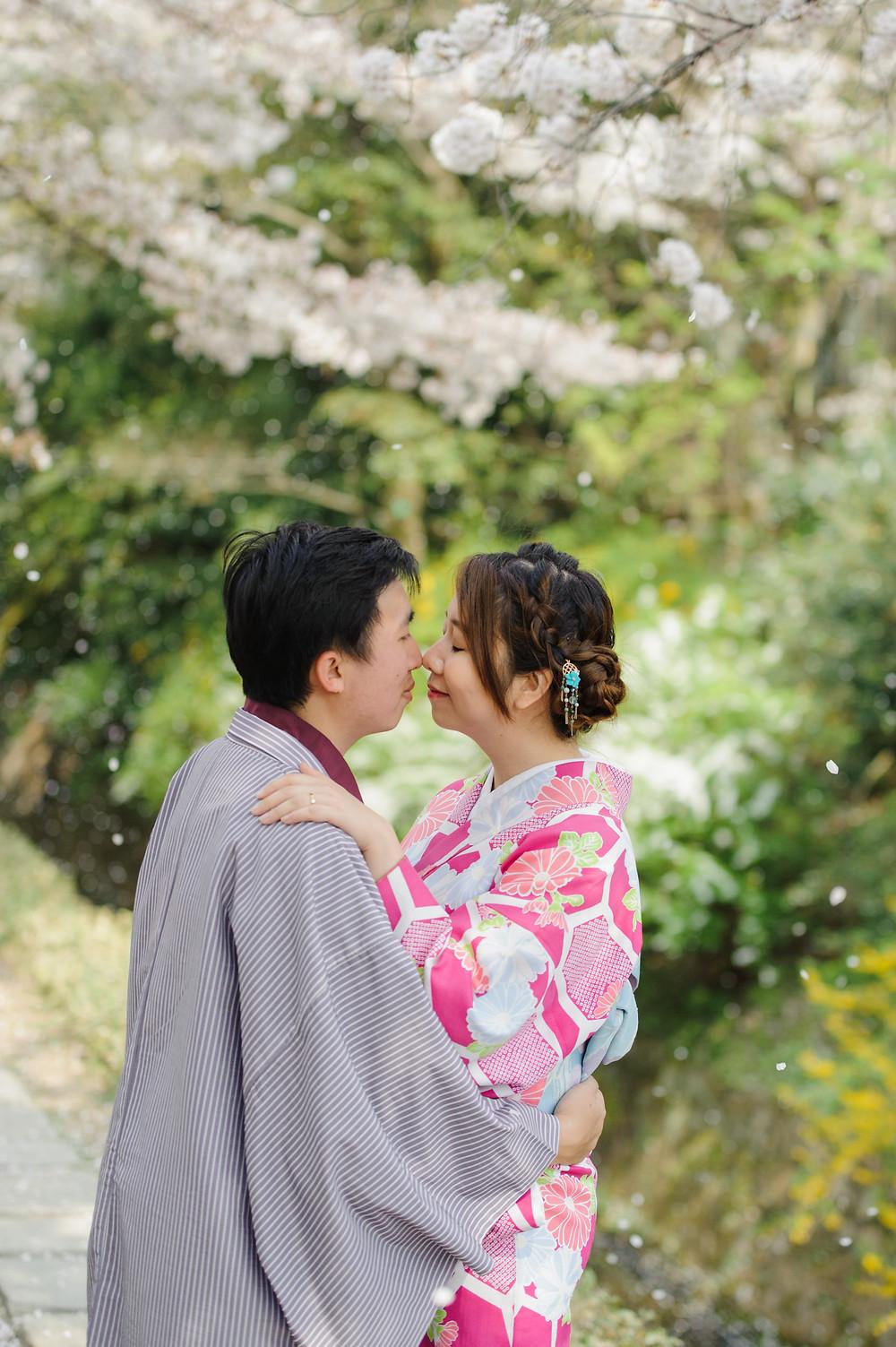 Sakura snow falling around the couple