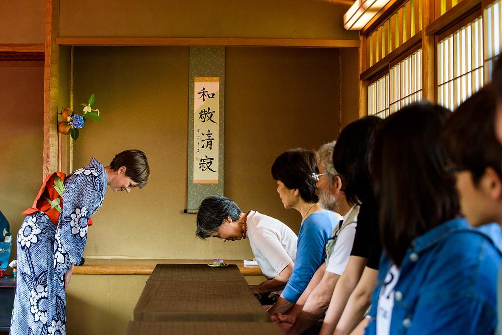 Woman serving tea at Ajisai