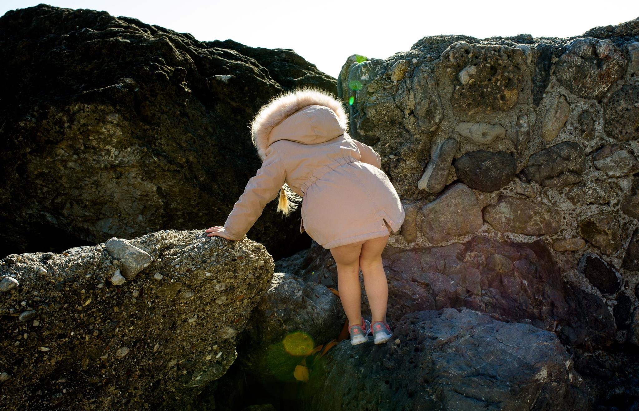 pants-less and climbing on rocks