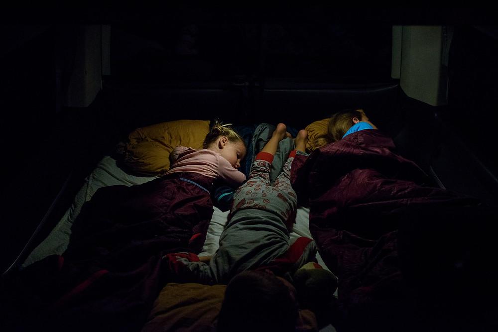 kids sleeping in a camper
