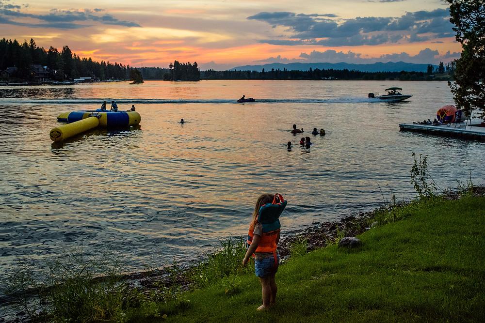 she watching everyone play at the lake