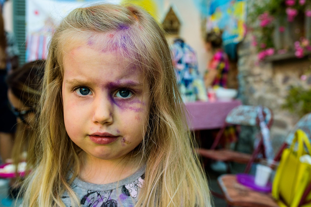 Little girl with a purple face