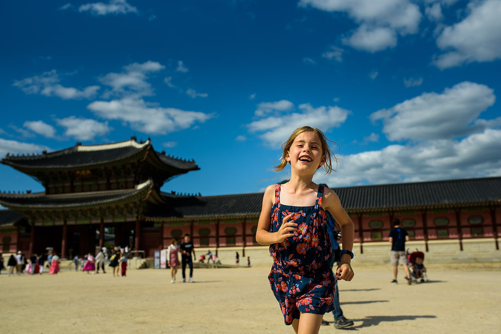 Amelia runs to me in front of the temple