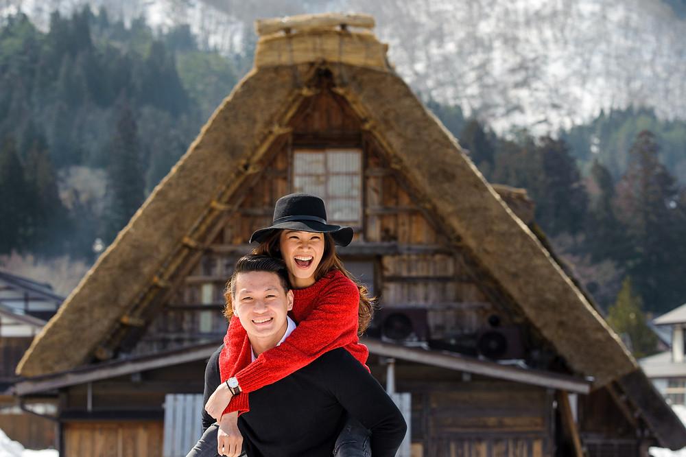 Vivi wearing a black hat, on Mika's shoulders