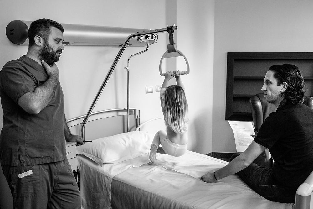 girl hangs above hospital bed