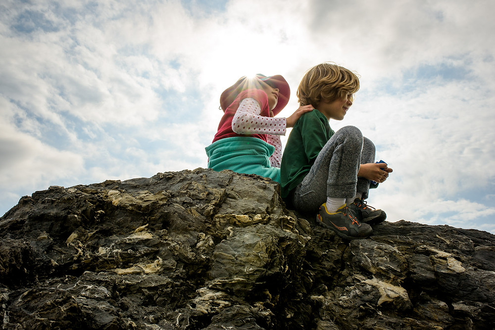 Amelia and dean on a high rock