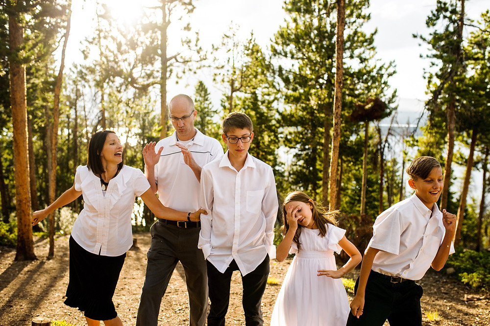family dances in white shirts