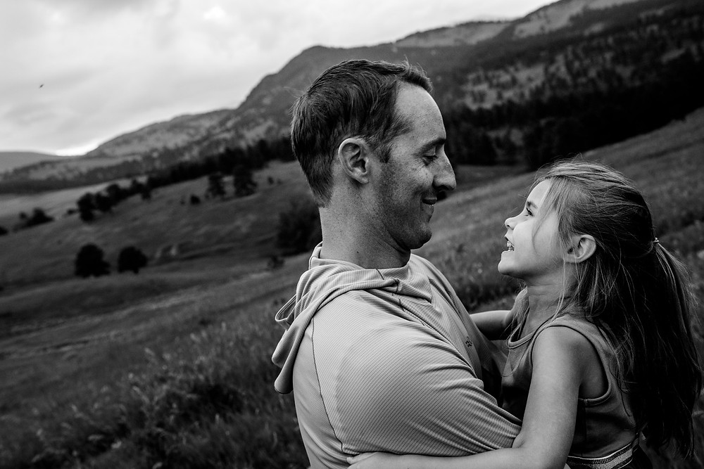 daddy and daughter in the mountains