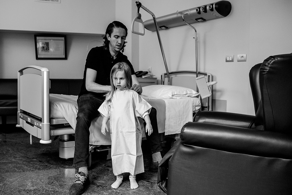 dad puts hospital gown on his daughter