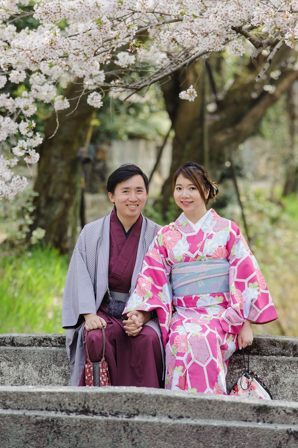 Sitting on a bridge under Sakura