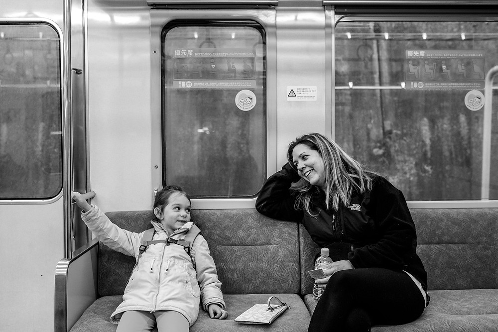 Mom and daugher on the train