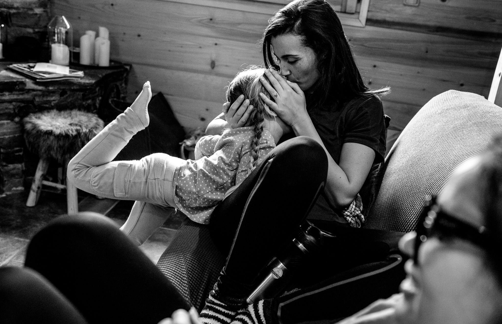 little girl kisses her aunt