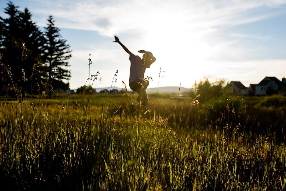 Boy dabbing in a field