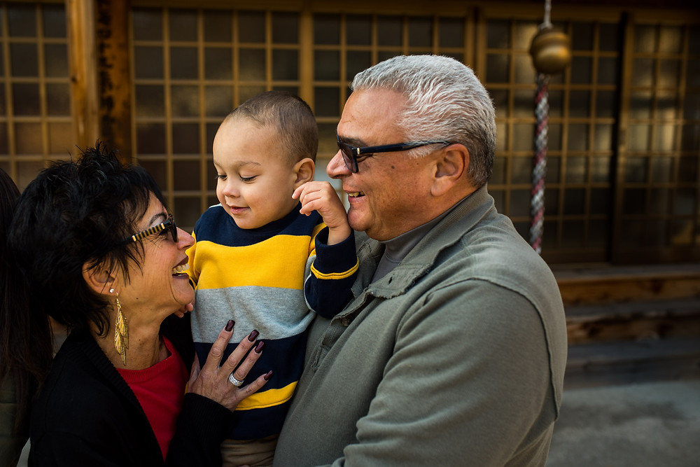 Pipa and Mima hold their grandson Braxton at the shrine