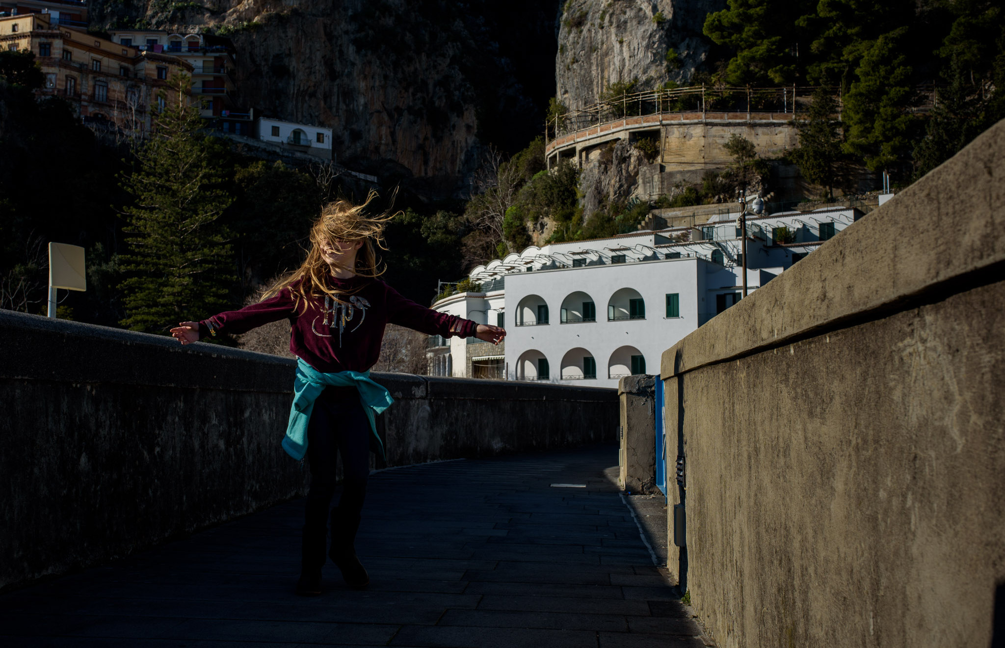 girl spins in the sun at Amalfi