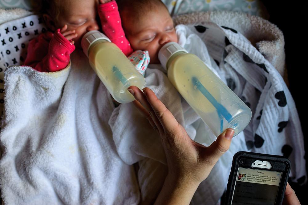Baby girls bottle feeding and Mama IG-ing