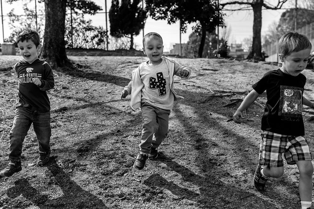 Braxton runs down the hill with his buddies