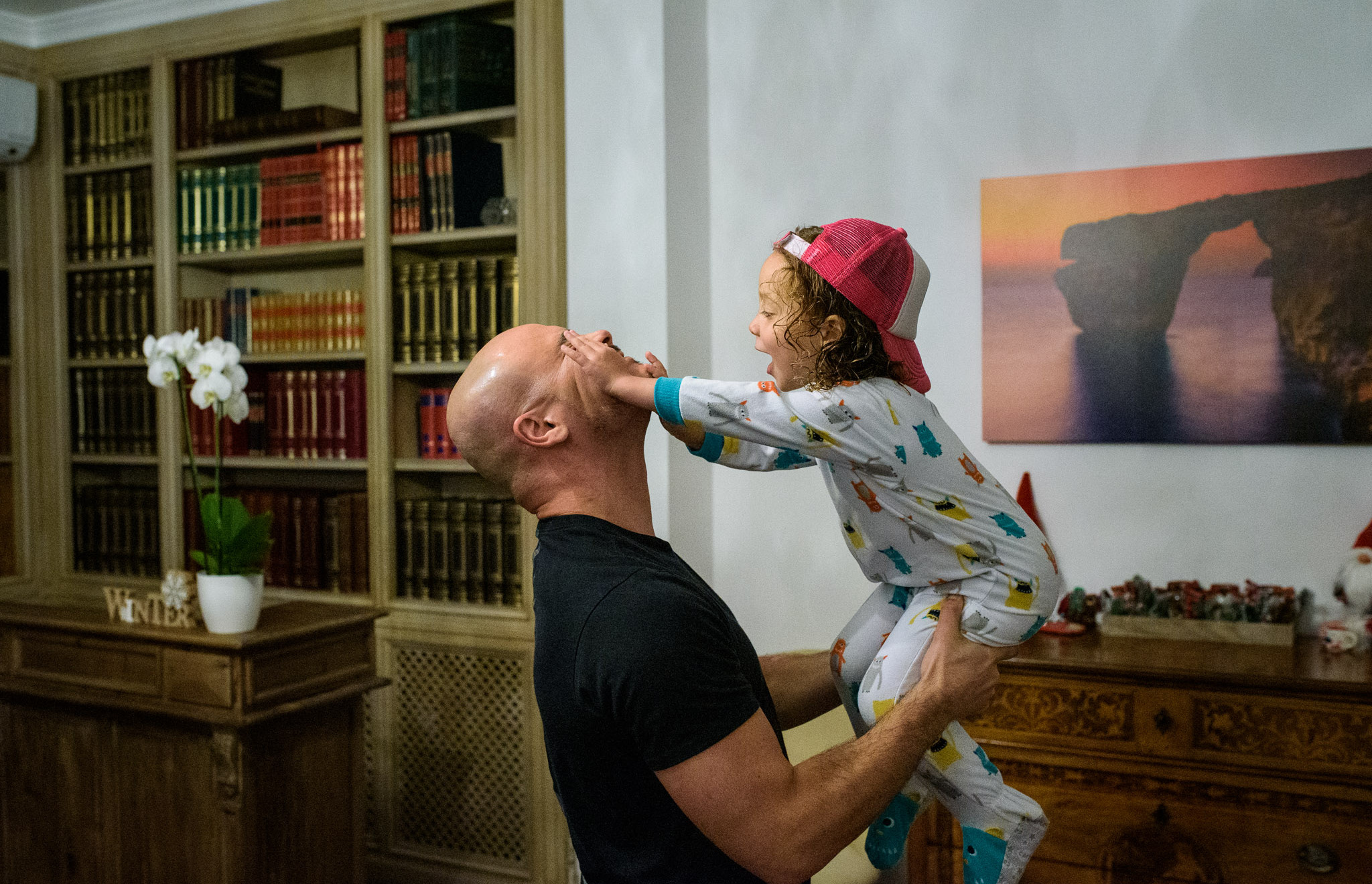girl pushes her dad's face
