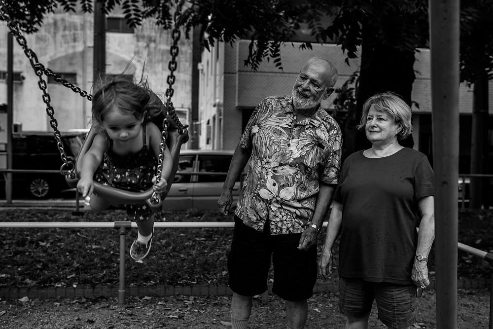 Grandparents watch Anna Bella swinging