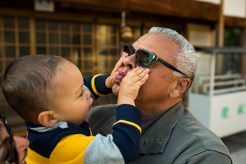 Braxton squeezes his grandfather's lips together playfully