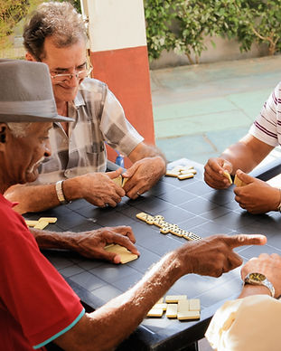 Retired people and senior citizens playing dominos