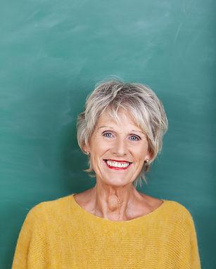 Portrait of happy senior female teacher