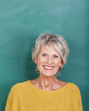 Portrait of happy senior female teacher