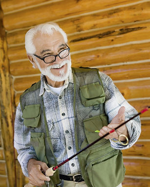 Happy male senior wearing a fishing vest holding a fishing pole