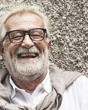 Senior gentleman with stylish clothing smiling