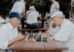 Senior citizens affected by memory loss playing chess
