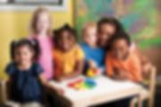 preschool-teacher-and-class-at-table-XLa