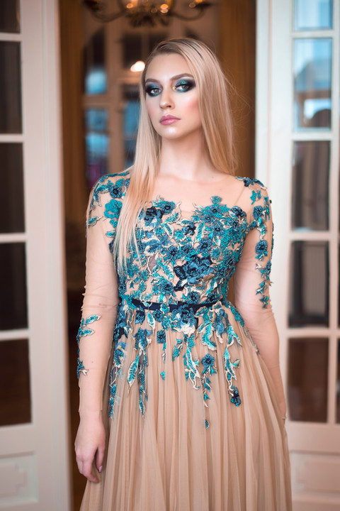 woman-wearing-blue-and-beige-floral-dres