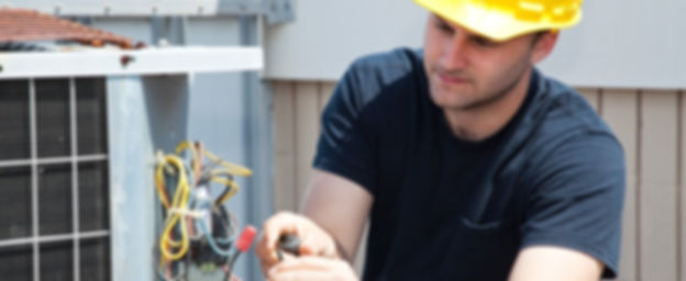 Technician working on air conditioer