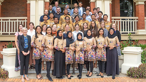 A formal photo of Indonesian and Australian participants and delegates standing on steps