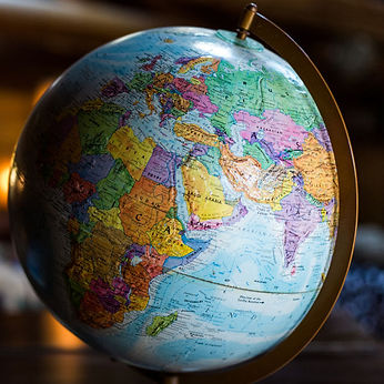 A colourful globe of the world map showing the  Africa, European and Asian continents