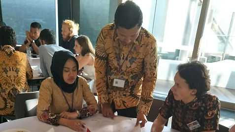 Three Indonesian AIYEP students  working together on a program task