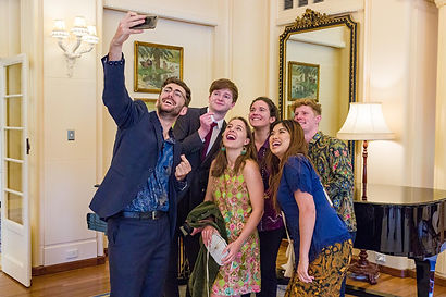 A photo of Australian AIYEP participants laughing as they take a selfie photograph