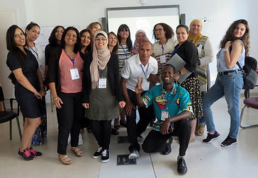 A happy group of women and men who have worked together in a learning session