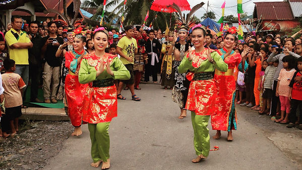 An Australian AIYEP participant leads and Indonesian ceremony in a village street lined with people