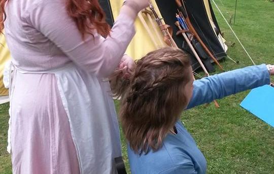 Lady's braid their hair!