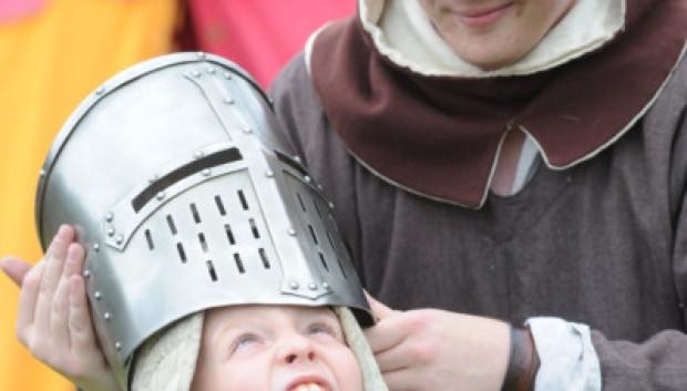 Kid tries on a Helmet