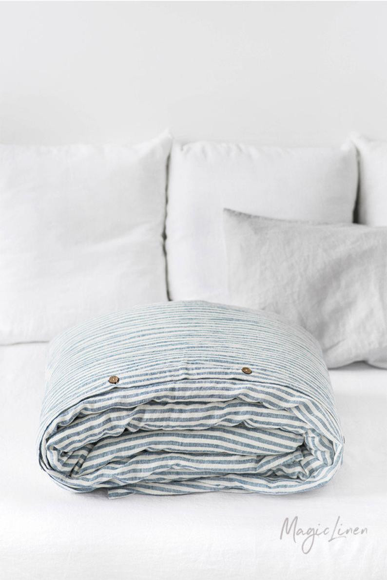 Eco Friendly organic duvet cover, white and blue strips. Click on the image to shop directly from Magic Linen maker