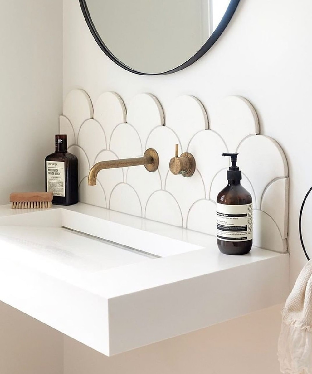 Spa bathroom fittings - stone sink and vintage gold tap.