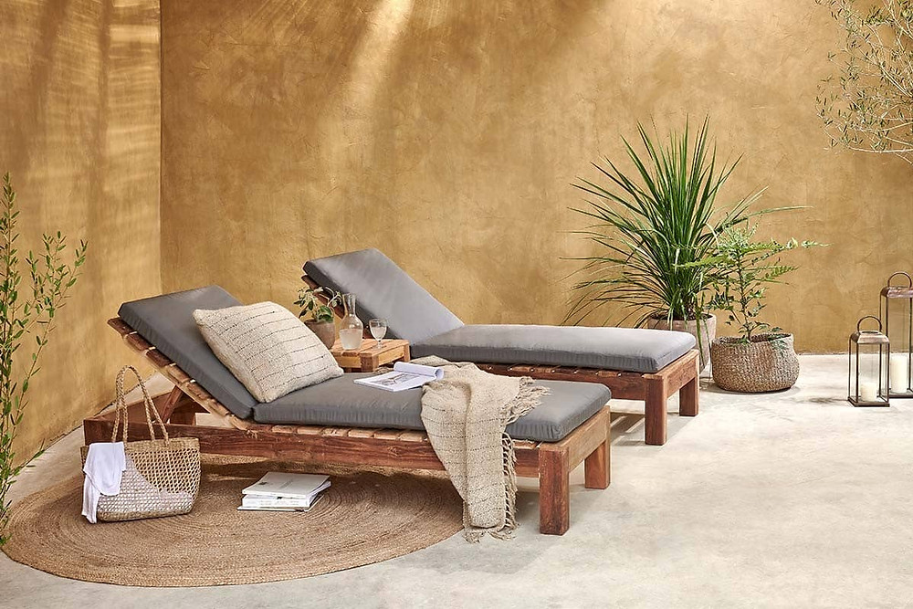 wooden sun loungers with grey padding.