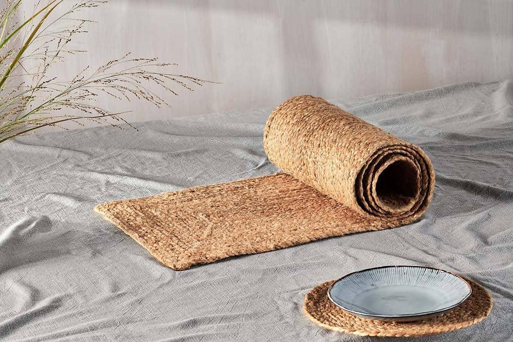 braided hemp table runner on a grey linen cloth