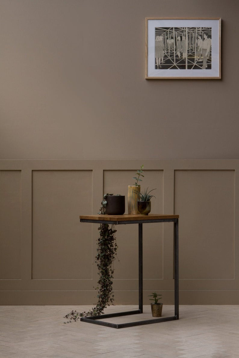 Sustainable  oak side table as a bathroom plant holder