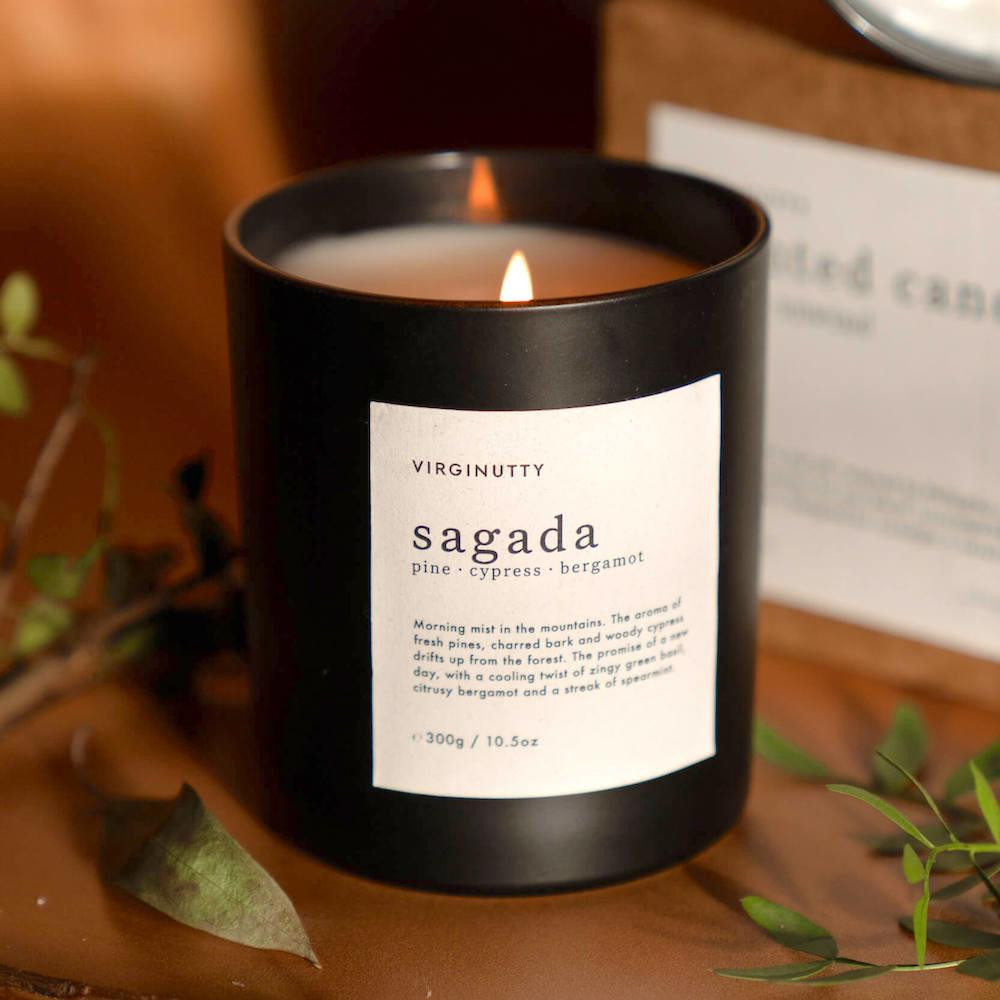 Vegan Candle containing notes like pine, bergamot and cypress.
