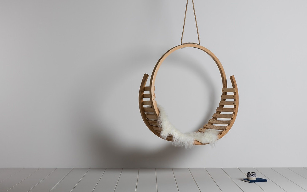 round hanging chair made of sustainable ash wood