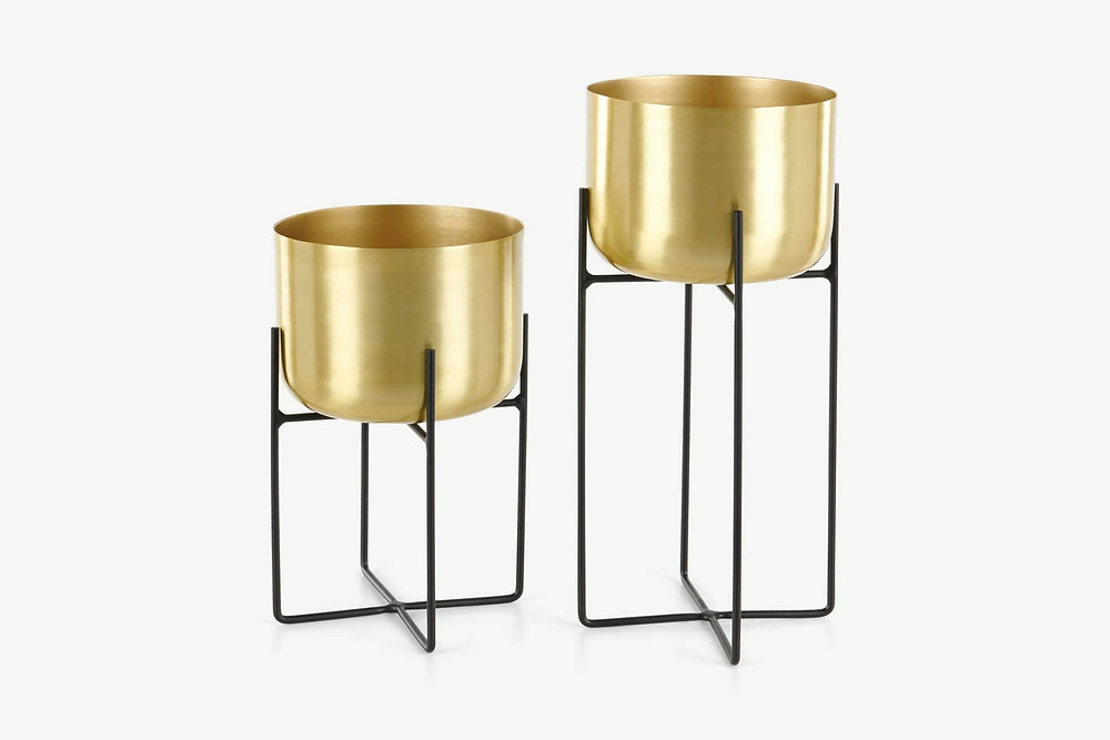 brass plant stands with minimal sleek black legs in black. Click on the image to shop the stands on made.com